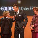Kai Pflaume mit Wera Röttgering und dem 15-jährigen Lucas